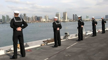 Sailors standing at Parade Rest.