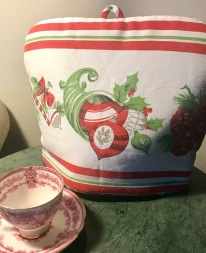 Cute Christmas Cozy with red & white china cup & saucer.